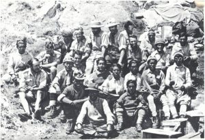 European mountaineers and Himalayan porters at the Base Camp. The German Expeditions in Siniolchum and Nanga Parbat